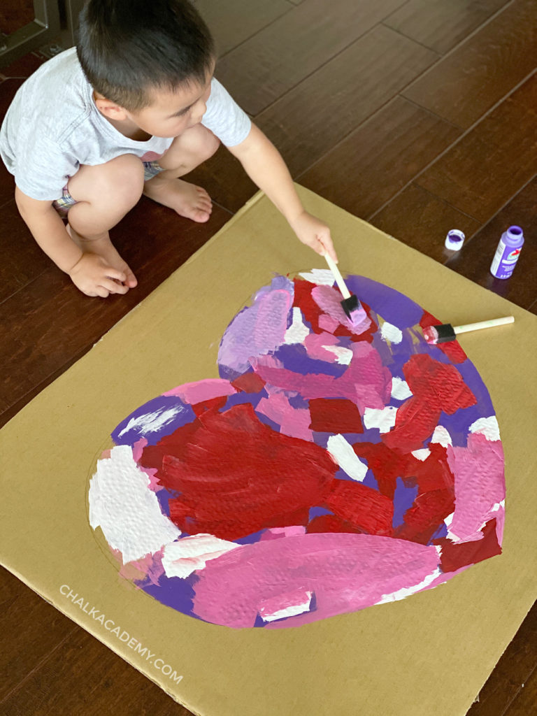 kids painting cardboard heart - sibling activity for Valentine's Day